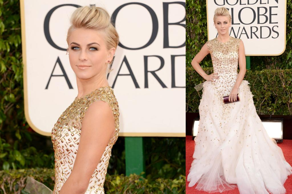 Actress Julianne Hough arrives in a Monique Lhuillier tulle white and gold gown. This girl definitely loves to sparkle on the carpet, and while there's no slamming this dress, we find the Gwen Stefani-style quiff an unsettling hair choice.