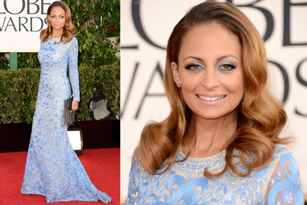 Nicole Richie's Naeem Khan dress is actually one of our faves of the night, but zoom in and all we can see is blue eyeshadow, blue eyeshadow, blue eyeshadow. For some reason, sky blue eyes always look badly applied to us.