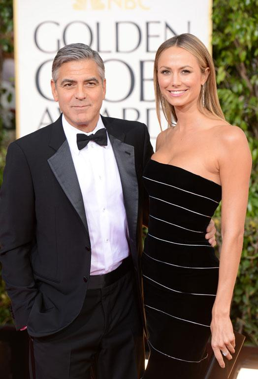 Actor George Clooney and actress Stacy Keibler arrive, with the former-wrestler proving she's one of the only women in the world that can look good in horizontal stripes in form-fitting Armani Prive.