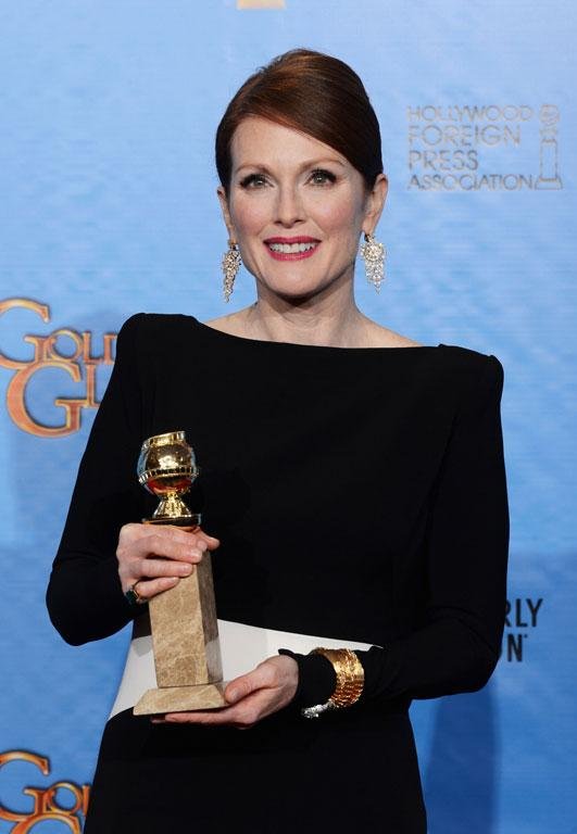 Actress Julianne Moore with her award for Best Actress in a TV Movie or Miniseries for Game Change.