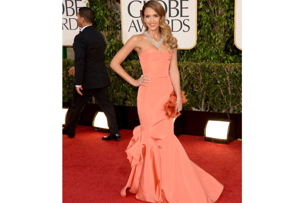 Jessica Alba is setting herself up as quite the fashionista, and we love this salmon-pink Oscar de la Renta gown, adore the lipstick colour and even, despite our better judgement, kind of like the taxidermy-chic clutch.