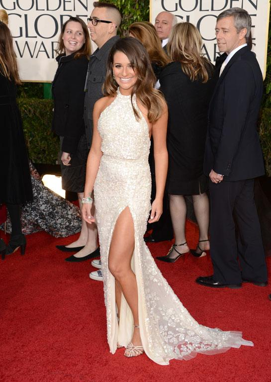 A stark improvement on Lea Michele of Glee fame's weird ice-skater-meets-bodybuilder look from last year's GG's, this white halter is by Lea's designer-of-the-moment Elie Saab. Safe for her, but still pretty.