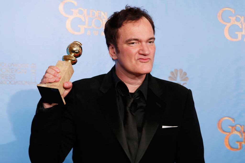 Director Quentin Tarantino holds the award for Best Screenplay - Motion Picture for Django Unchained.