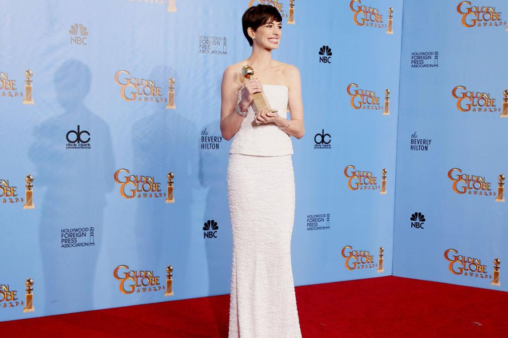 Anne Hathaway holds the award she won for Best Supporting Actress in a Motion Picture, Comedy or Musical for her work in Les Miserables.