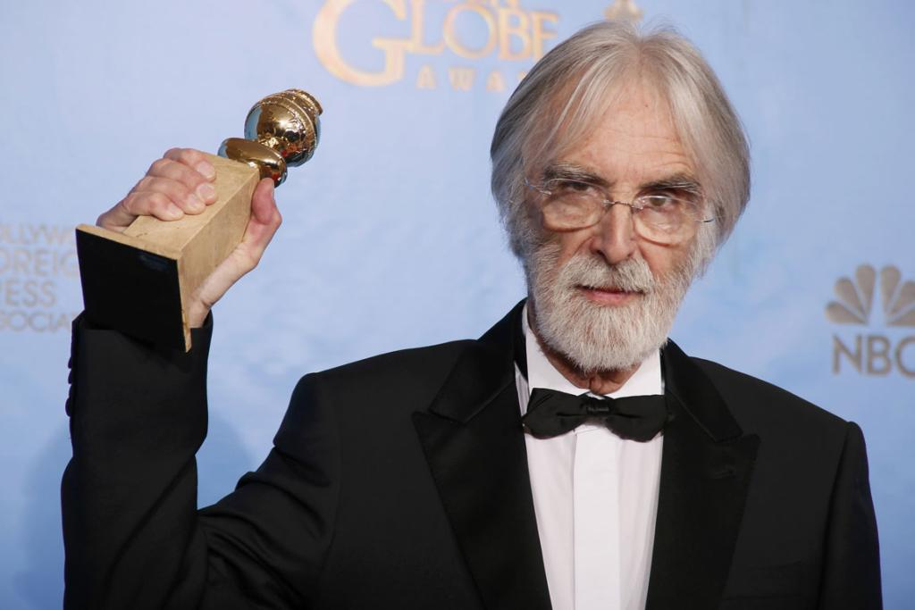 Director Michael Haneke holds his award for Best Foreign Language Film for Amour.