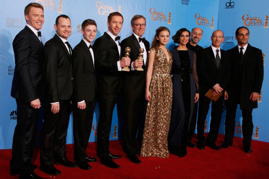 The cast and producers of the tv drama series Homeland, which won Best Television Drama from left, actor Diego Klattenhoff, executive producer Gideon Raff, actor Timothie Chalamet, actor Damien Lewis, executive producer Alex Gansa actress Morgan Saylor, actress Morena Baccarin, actor David Marciano, executive producer Howard Gordon and actor Navid Negahban.