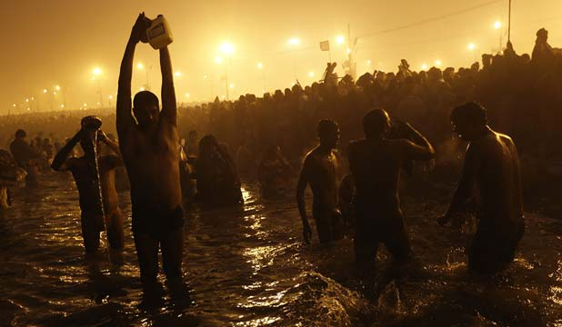 TO THE RIVER: Hindu devotees pray as they attend the first Shahi Snan (grand bath) at the ongoing Kumbh Mela, or Pitcher Festival, in the northern Indian city of Allahabad.