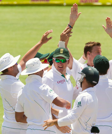 South Africa's players celebrate the wicket of New Zealand's Colin Munro on day four of the second test.