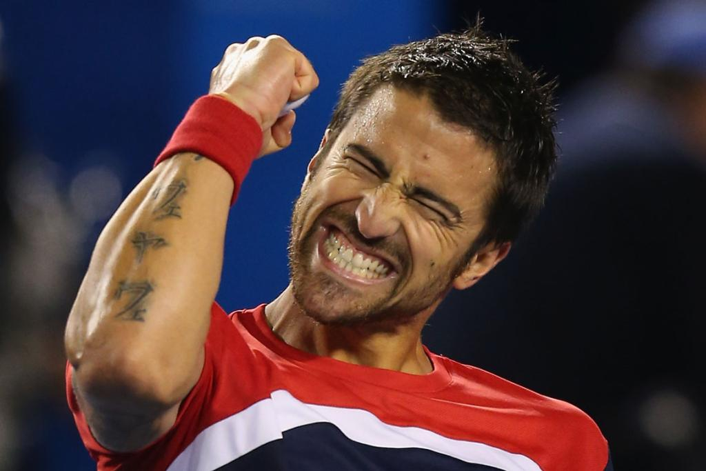 Janko Tipsarevic celebrates his straight sets win over Lleyton Hewitt in the first round.