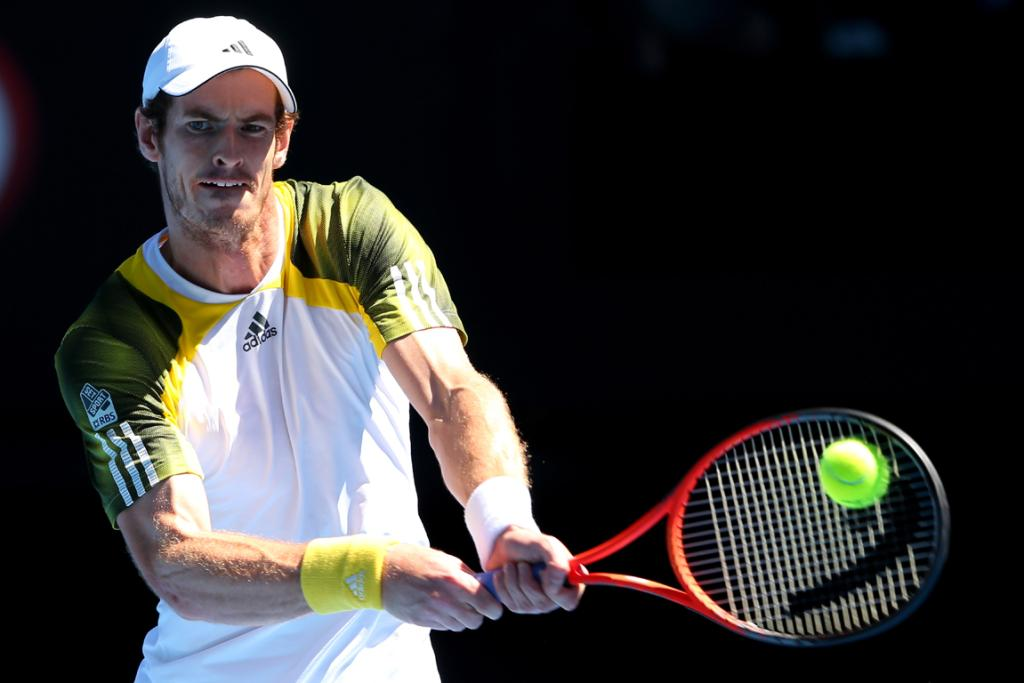 Andy Murray returns a shot against Robin Haase on day two of the Australian Open.