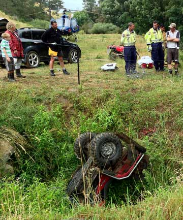 Emergency workers inspect the site where farmer had an accident on his quad bike