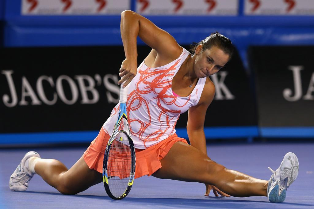Jarmila Gajdosova of Australia does the splits in her first round match against Yanina Wickmayer.
