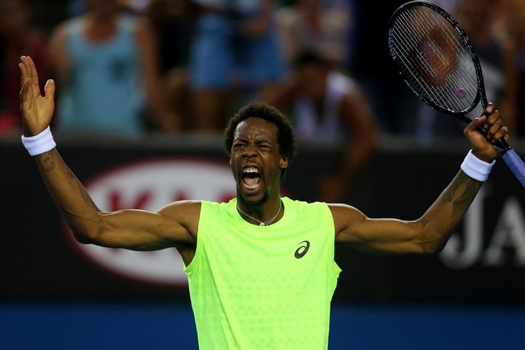 Gael Monfils celebrates a point during his first round match.