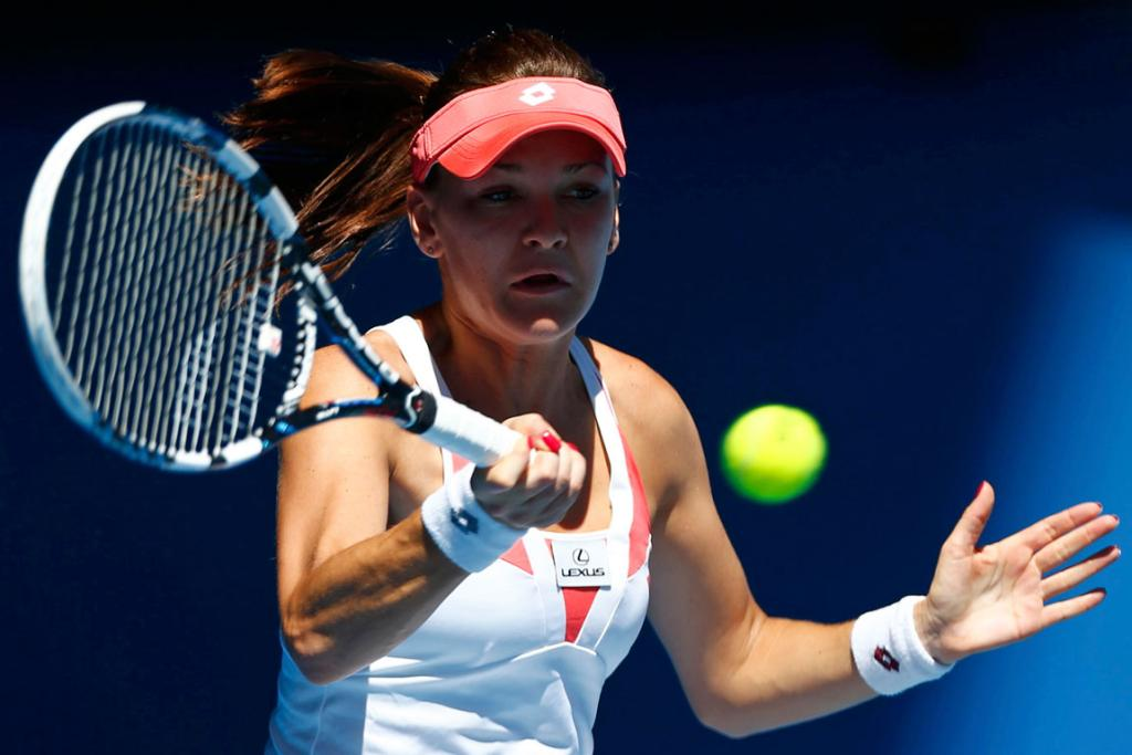 Agnieszka Radwanska of Poland hits a return to Irina-Camelia Begu of Romania.
