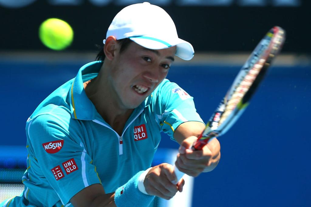 Kei Nishikori of Japan plays a backhand in his second round match against Carlos Berlocq of Argentina.