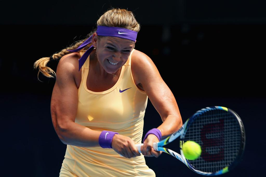 Victoria Azarenka of Belarus plays a backhand in her second round match against Eleni Daniilidou of Greece.