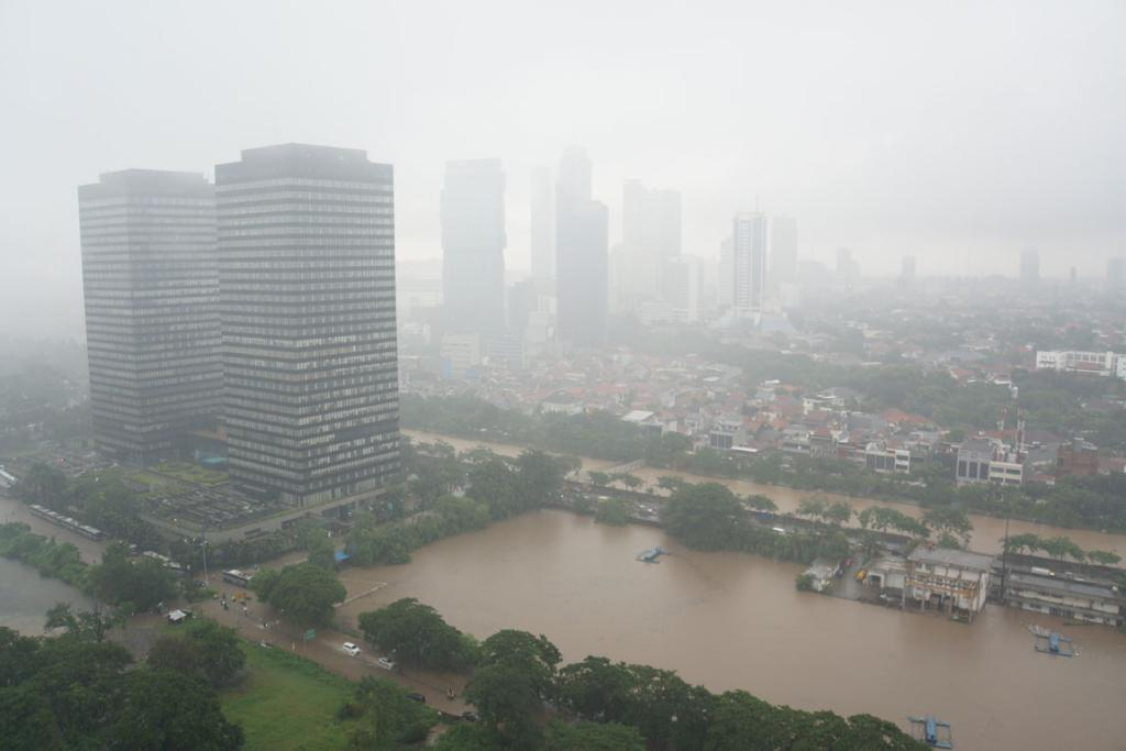 A stormy outlook in Jakarta from the Four Seasons Residences and Hotel.
