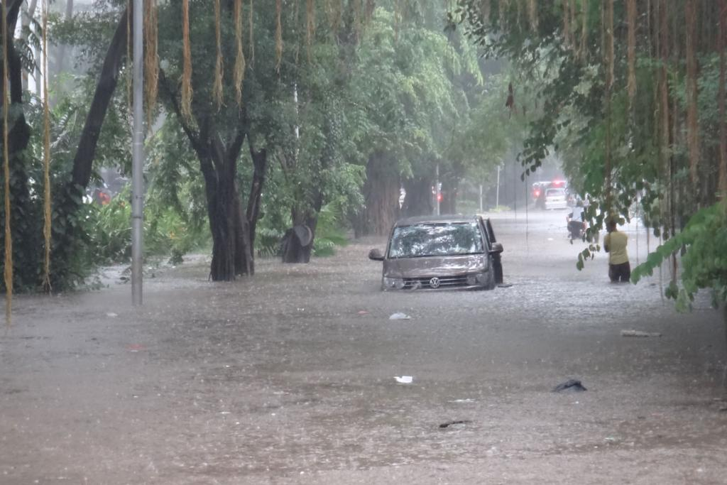 A large vehicle became stranded when its driver attempted to take on a badly flooded street.