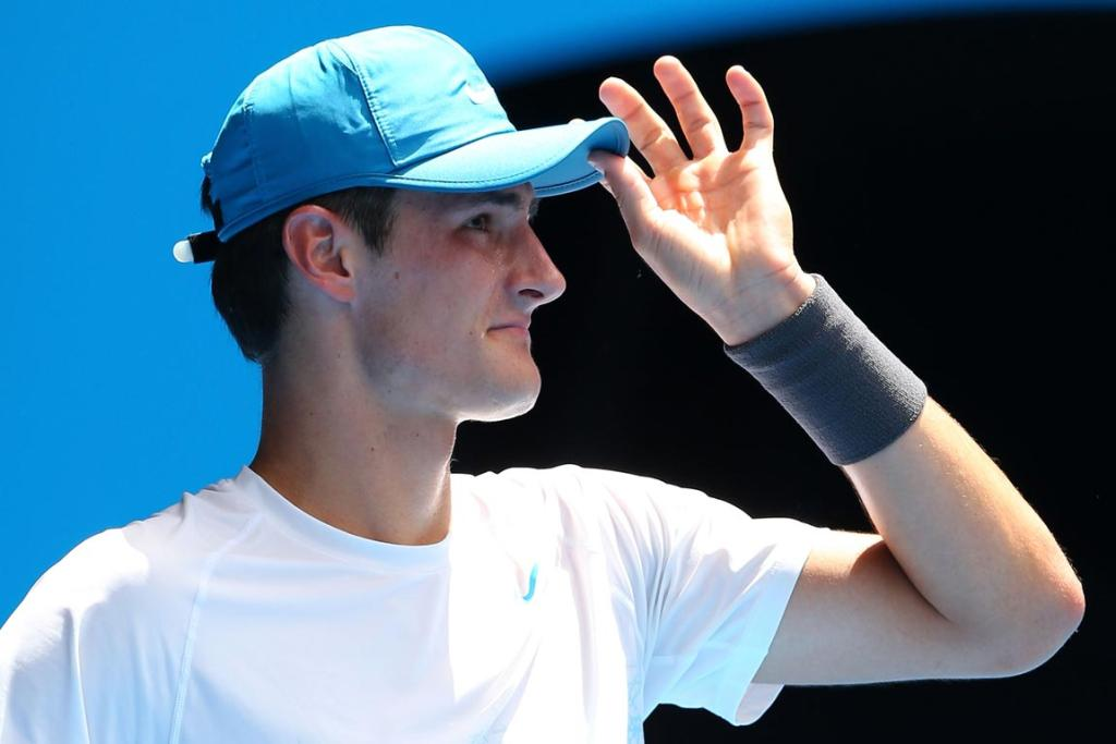 Bernard Tomic recovered from losing a first set tie-breaker to defeat German qualifier Daniel Brands in four sets.