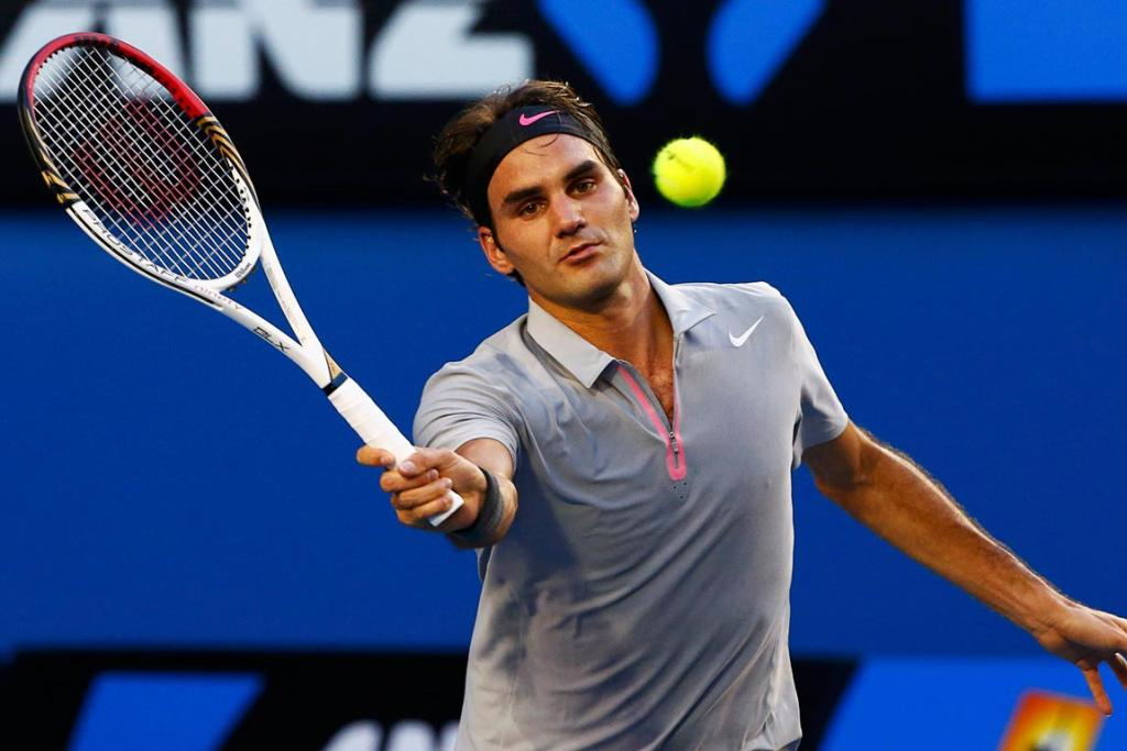 Roger Federer picked up early breaks in each set to defeat Nikolay Davydenko in straight sets in Melbourne.