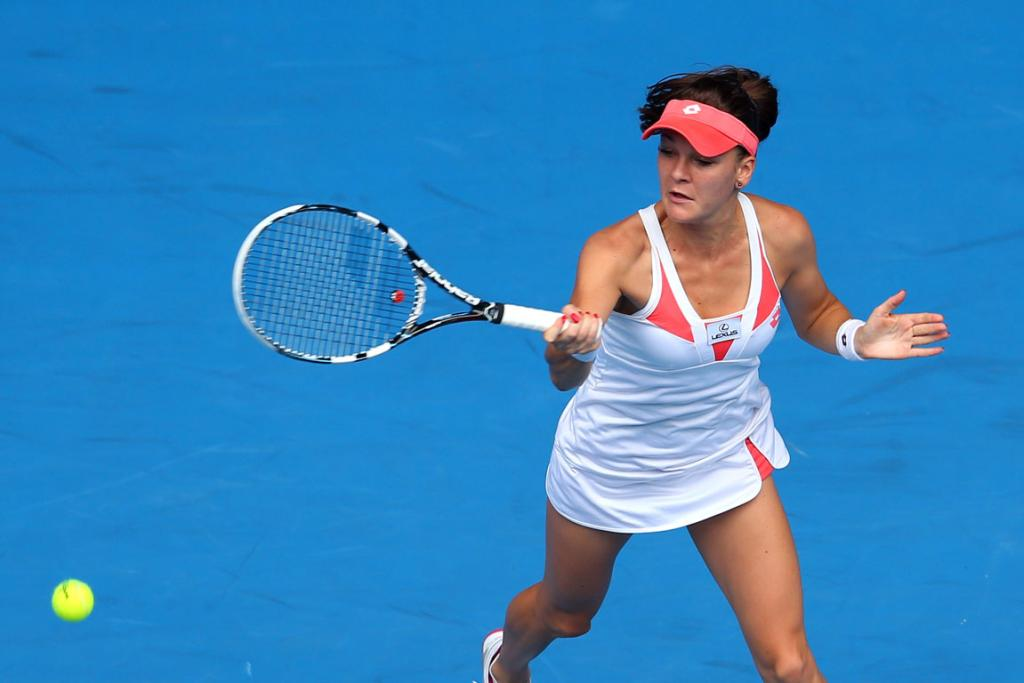 Agnieszka Radwanska of Poland plays a forehand in her third round match against Heather Watson of Great Britain.
