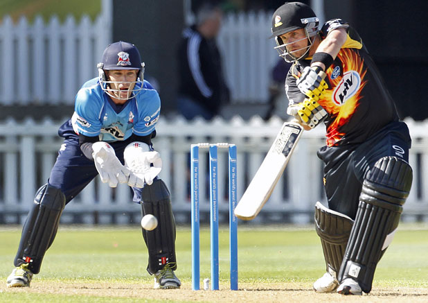 ON SHOT: Wellington Firebirds batsman Michael Papps in action as Auckland Aces keeper Reece Young looks on.