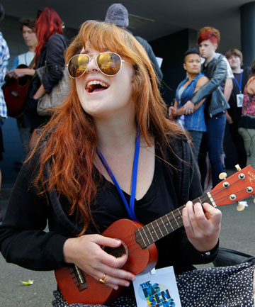 WARMING UP: Moira Jones, 20, plays the ukelele while queuing for the the X Factor pre-audition at Wellington High School.