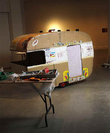 Leek's cardboard caravan is set up for the Desk Collection exhibition.
