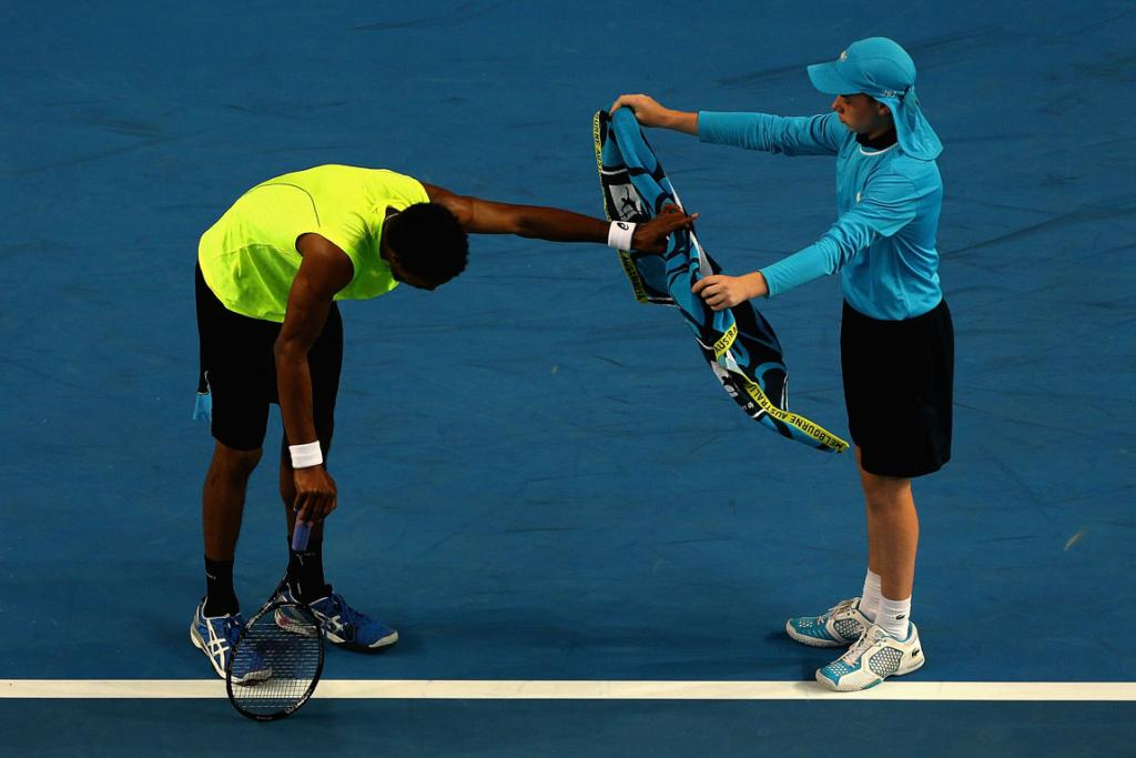 Gael Monfils is doubled over with exhaustion during his epic third round match against Gilles Simon.