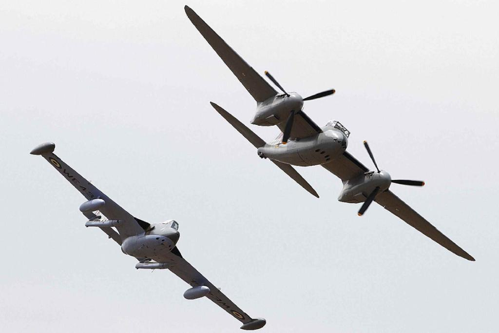 A one-of-a-kind de Havilland Mosquito, the star of the Wings Over Wairarapa show yesterday, leads a de Havilland Venom.