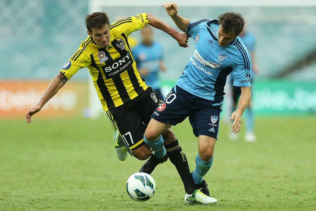 Alessandro Del Piero and Vince Lia compete for the ball.