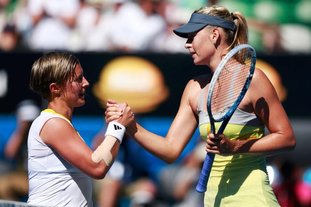Maria Sharapova (right) of Russia after her fourth round match against Kirsten Flipkens.