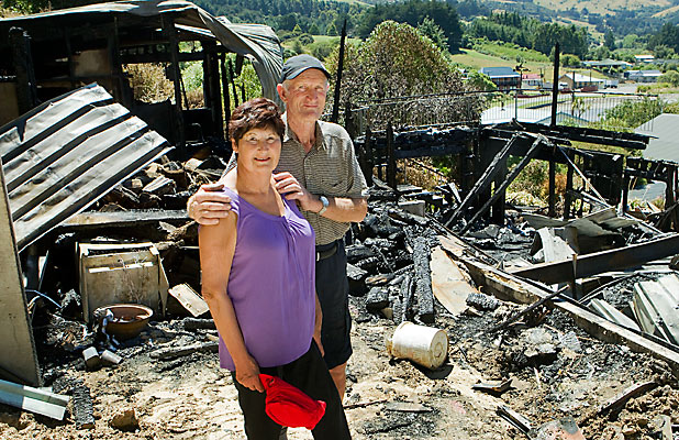 ASHES: Barbara and Bruce Kay at the remains of their Duvauchelle home.