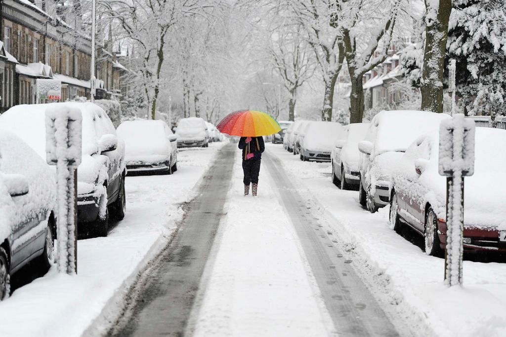 A girl walks along a snow covered street in Knaresborough, northern England.