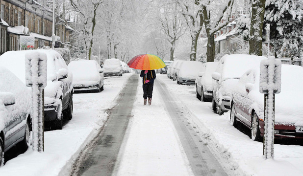 BIG FREEZE: A girl walks along a snow covered street in Knaresborough, northern England.