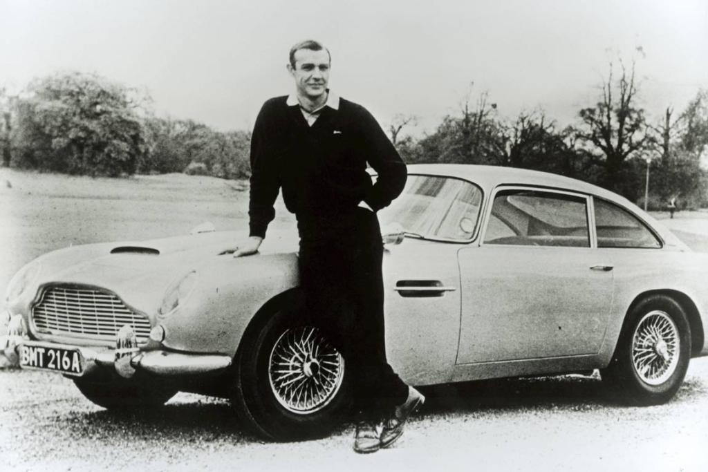 Actor Sean Connery poses on an Aston Martin DB5 during the filming of the James Bond caper Goldfinger in 1964. The luxury brand has marked the official anniversary of its founding 100 years ago with a ceremony in Chelsea's Henniker Mews - the original home of the company that went on to become Aston Martin, founded on January 15, 1913.