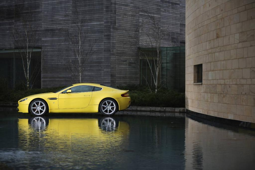 An Aston Martin is displayed outside the company headquarters and production plant in Gaydon, England.