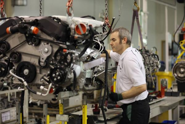 A technician works on the assembly line building Aston Martin motor cars at the company headquarters and production plant in Gaydon, England.