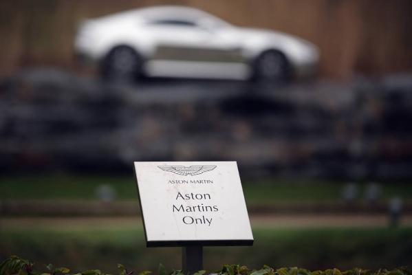 A parking sign for Aston Martin motor cars only sits outside the company headquarters and production plant in Gaydon, England.