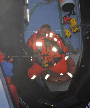 RESCUED: Alain Delord being winched on to the cruise ship, after days drifting in life raft.