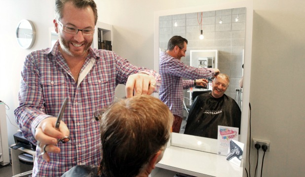 TIME IS MONEY: Headspace's Niq James, cutting  the hair of Steve Smith says his charges are based on time, not gender.