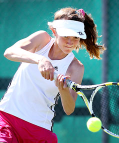 Pukekura's Louise Wells powers into a backhand in New Plymouth at the weekend.