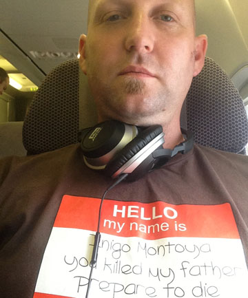 FAMOUS LINE: Wynand Mullins wearing the T-shirt which caused a stir on a flight to Auckland.  A flight attendant approached him saying some people felt intimidated by the words.
