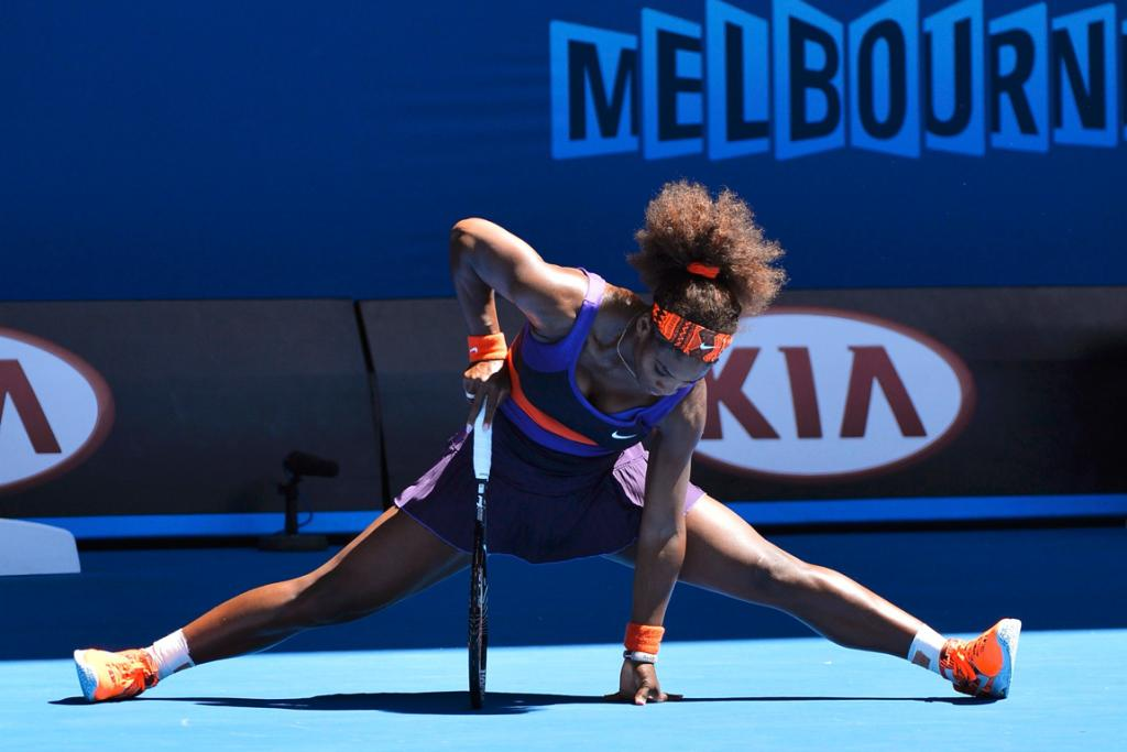 Serena Williams does the splits during her quarterfinals loss to compatriot Sloane Stephens.