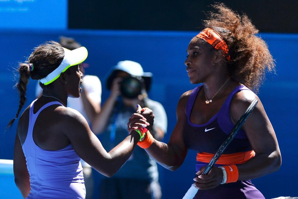 Sloane Stephens of the US (R) shakes hands with compatriot Serena Williams after defeating her in their women's singles quarter-final match.