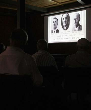 EARLY DAYS: The Herald's former Sophia St offices feature in the new documentary about the history of Timaru newspapers, which premiered at the South Canterbury Museum yesterday. Inset, the audience watch the 12-minute film, one in a series charting the history of the district.