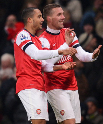 FIVE ALIVE: Arsenal's Theo Walcott (left) and Lukas Podolski celebrate the team's fourth goal in their 5-1 romp over West Ham.