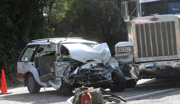 CARNAGE: The mangled wreckage of the Holden Commodore that collided with a tanker truck in Havelock this morning