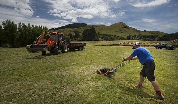 MULCHED AND MOWED: Wade Wilson lends a hand with his lawnmower near Woodville where the Honda International Motorcross 2013 NZ Grand Prix will be held this weekend.