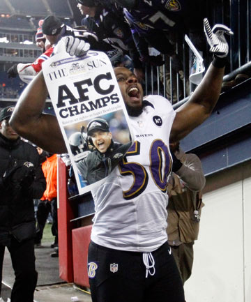 CHARMED CITY: Ravens linebacker Albert McClellan holds up a poster declaring Baltimore the AFC Champions after their victory over the New England Patriots.